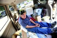"Homeless in Van.jpg Robert Wicks, who is currently homeless and living in his car, sits on his ""bed"" in the back of his van. July 26, 2012. Rachel Woolf/ For the Daily Camera"